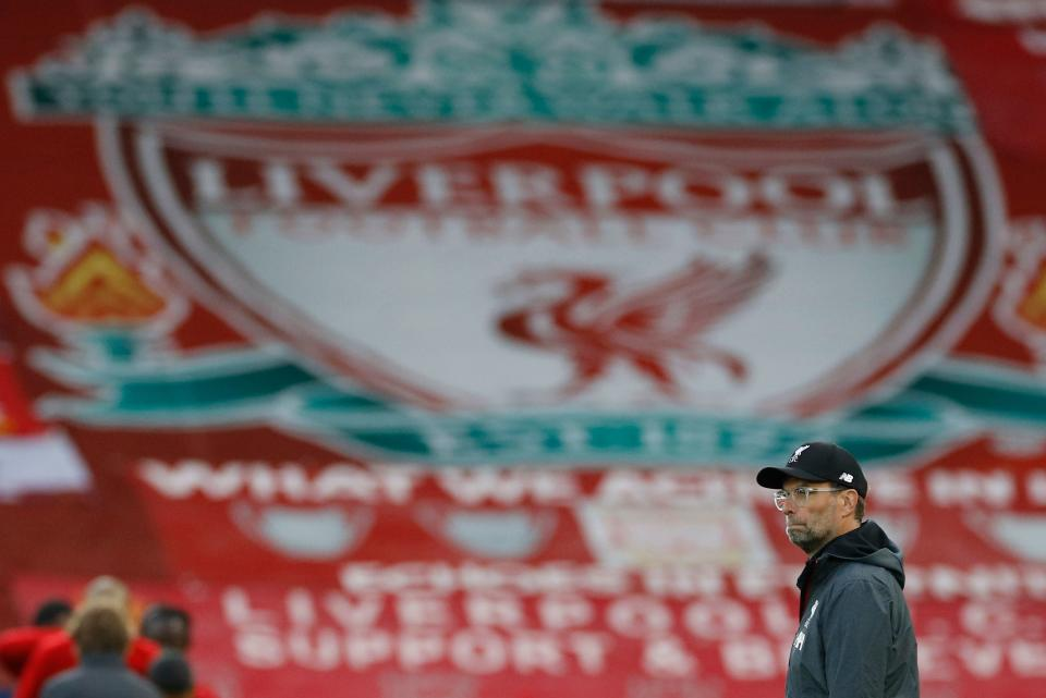 Liverpool manager Jurgen Klopp watches his players warm up for the Premier League football match between Liverpool and Chelsea at Anfield. (PHOTO: Phil Noble/POOL/AFP via Getty Images)