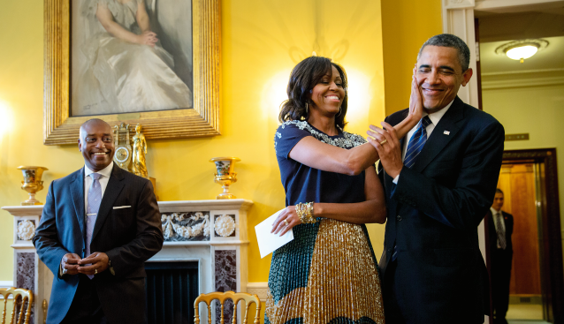 Michelle Obama playfighting with Barack. President Barack Obama has departure photos taken in the Oval Office, July 12, 2013. [Photo: Official White House Photo by Lawrence Jackson]