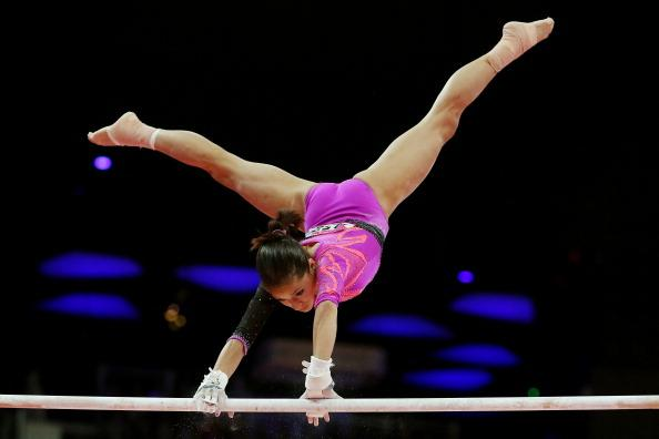 LONDON, ENGLAND - AUGUST 02:  Jessica Lopez of Venezuela competes on the uneven bars in the Artistic Gymnastics Women's Individual All-Around final on Day 6 of the London 2012 Olympic Games at North Greenwich Arena on August 2, 2012 in London, England.  (Photo by Ronald Martinez/Getty Images)