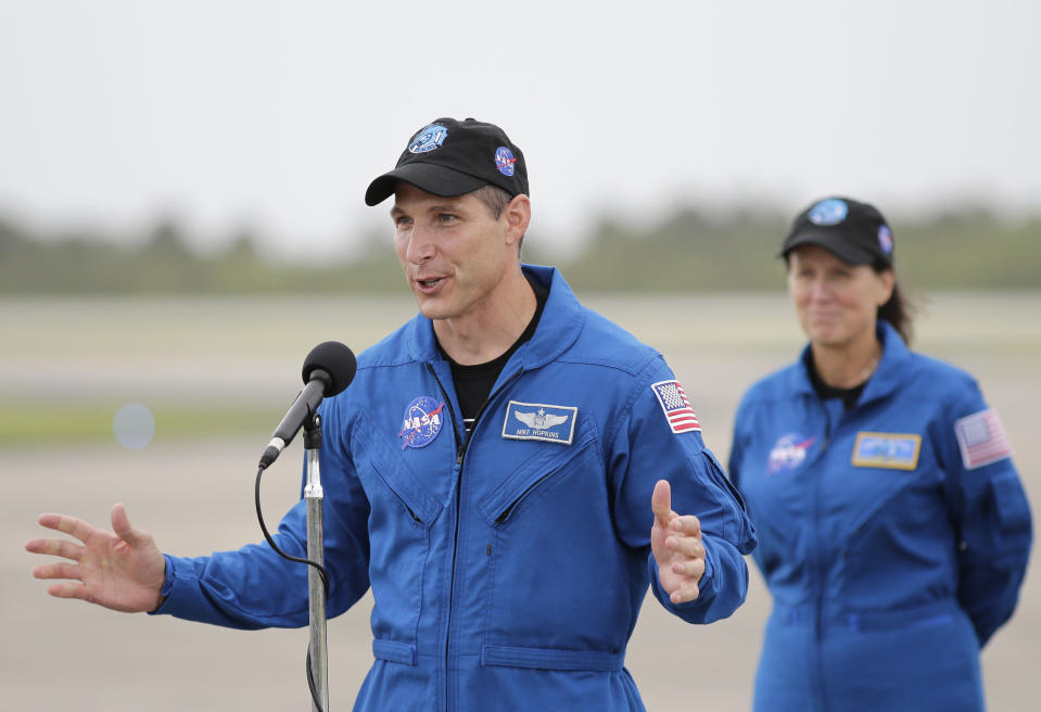 NASA Astronaut Michael Hopkins speaks as fellow crew member Shannon Walker looks on during a news conference after they arrived at the Kennedy Space Center, Sunday, Nov. 8, 2020, in Cape Canaveral, Fla. The astronauts will fly on the SpaceX Crew-1 mission to the International Space Station scheduled for launch on Nov. 14, 2020. (AP Photo/Terry Renna)