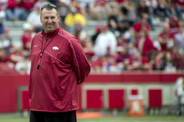 FILE - In this April 20, 2013, file photo, Arkansas head coach Bret Bielema watches his team warm up before of a spring NCAA college football game in Fayetteville, Ark. Bielema felt much more at ease at Arkansas in his second spring with the program. With the spring completed, the Razorbacks coach now hopes that comfort level translates into more wins for the school next season. (AP Photo/Gareth Patterson, File)