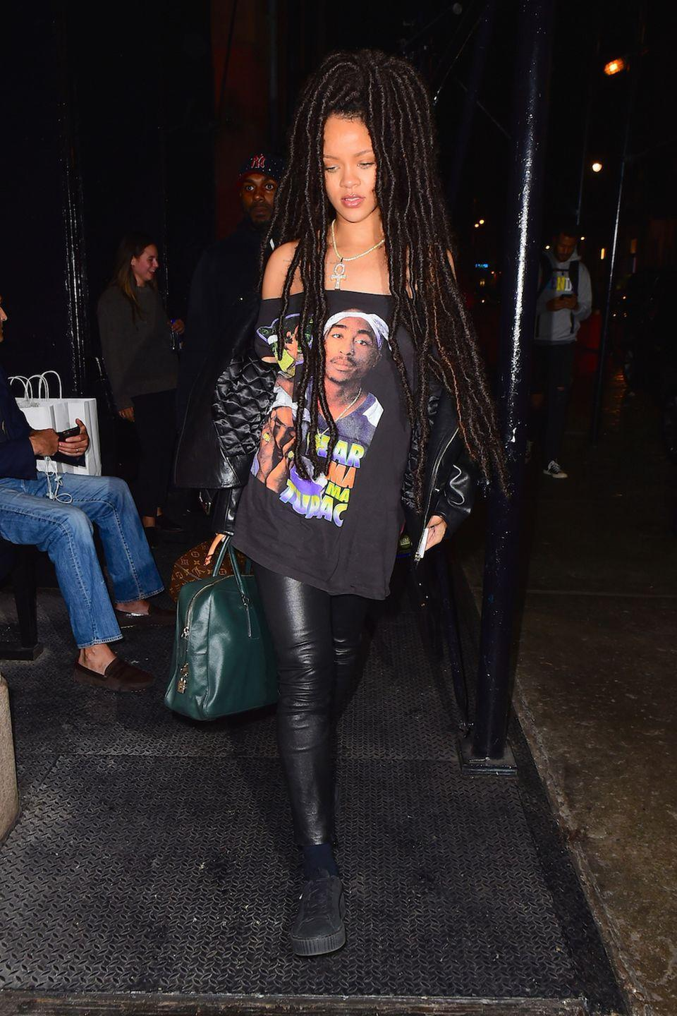 <p>In a leather jacket, off-the-shoulder Tupac t-shirt, leather leggings, black Fenty x Puma creepers, Louis Vuitton box bag, green leather tote and Moschino phone case in NYC.</p>