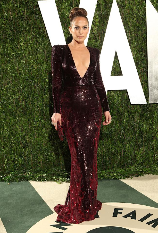 "Jennifer Lopez turned heads on the Oscars red carpet in a plunging, silver Zuhair Murad gown, but the diva extraordinaire looked even better at the annual Vanity Fair afterparty in yet another revealing Murad masterpiece. Luckily -- at the post-ceremony soiree -- J.Lo didn't suffer a second <a target=""_blank"" href=""http://movies.yahoo.com/blogs/oscars/jennifer-lopez-oscars-wardrobe-malfunction-did-her-dress-031227699.html"">wardrobe malfunction</a>. Her first frock may have showcased a bit too much skin, but her encore ensemble was utter perfection."