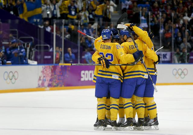 Team Sweden celebrates after scoring a goal against Finland during the second period of a men's semifinal ice hockey game at the 2014 Winter Olympics, Friday, Feb. 21, 2014, in Sochi, Russia. (AP Photo/Julio Cortez)