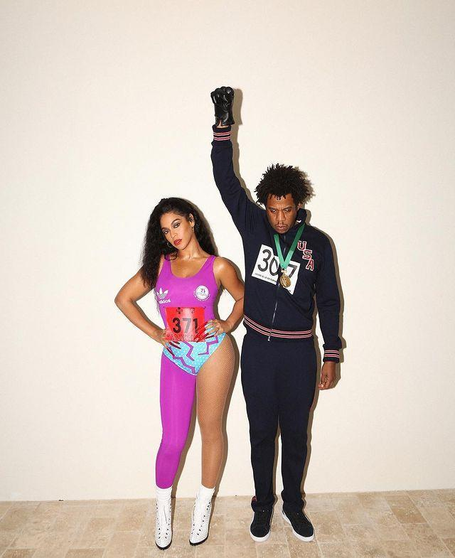 """<p>The superstar couple paid homage to the worlds of sport and activism through their 2018 costumes. Bey went as American sprinter Florence 'Flo Jo' Griffith Joyner while Jay was Tommie Smith, the athlete who famously protested racism through the Black Power salute at the 1968 Olympics.</p><p><a href=""""https://www.instagram.com/p/BpocxnRFKRa/"""" rel=""""nofollow noopener"""" target=""""_blank"""" data-ylk=""""slk:See the original post on Instagram"""" class=""""link rapid-noclick-resp"""">See the original post on Instagram</a></p>"""