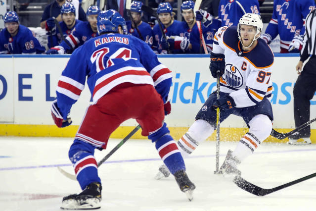 Edmonton Oilers center Connor McDavid (97) skates against New York Rangers right wing Kaapo Kakko (24) during the first period of an NHL hockey game, Saturday, Oct. 12, 2019, at Madison Square Garden in New York. (AP Photo/Mary Altaffer)