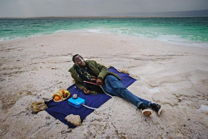 A man picnics by the Dead Sea.