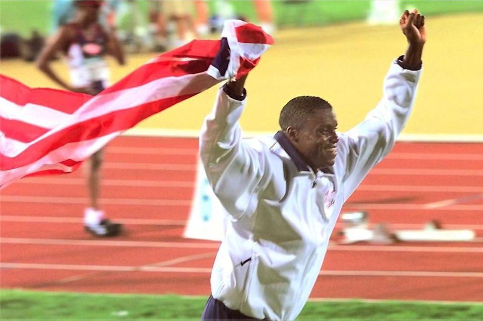 Lewis at the 1996 Summer Olympics. (Photo: JEFF HAYNES/AFP via Getty Images)