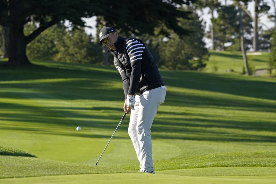 Jordan Spieth chips the ball onto the 10th green of the Spyglass Hill Golf Course during the second round of the AT&T Pebble Beach Pro-Am golf tournament Friday, Feb. 12, 2021, in Pebble Beach, Calif. (AP Photo/Eric Risberg)