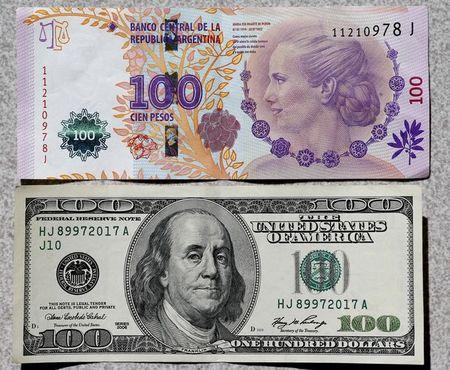 An Argentine 100 Pesos Bank Note Is Displayed Next To The A U S Dollar