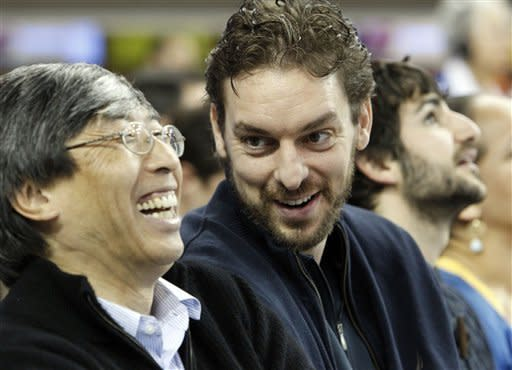 Los Angeles Lakers forward Pau Gasol, right, chats with Patrick Soon-Shiong, a minority owner of the Lakers, at an Arizona State-UCLA NCAA college basketball game in Los Angeles Wednesday, Feb. 27, 2013. (AP Photo/Reed Saxon)