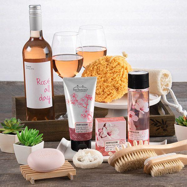 """<p><strong>Gourmet Gift Baskets</strong></p><p>gourmetgiftbaskets.com</p><p><strong>$109.99</strong></p><p><a href=""""https://go.redirectingat.com?id=74968X1596630&url=https%3A%2F%2Fwww.gourmetgiftbaskets.com%2FSpa-Gift-Basket-For-Women.asp&sref=https%3A%2F%2Fwww.goodhousekeeping.com%2Fholidays%2Fgift-ideas%2Fg34054234%2Fbest-gift-baskets-for-women%2F"""" rel=""""nofollow noopener"""" target=""""_blank"""" data-ylk=""""slk:Shop Now"""" class=""""link rapid-noclick-resp"""">Shop Now</a></p><p>If she could use a relaxing night in, set her up with this gift basket that's complete with rosé, a loofah, body wash, and other bath products. </p>"""