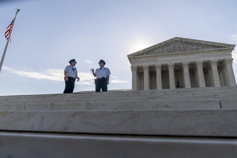 Police officers talk in front of the Supreme Court in Washington, Monday, June 7, 2021. (AP Photo/Andrew Harnik)