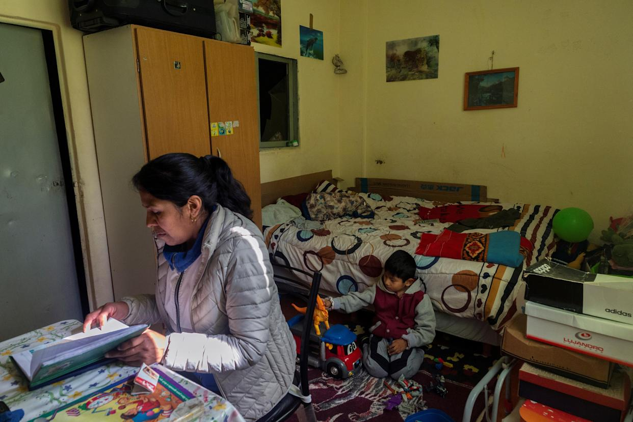 Brigida Simaniz checks the homework of her son Nicolas at her apartment in the shantytown of Bajo Flores in Buenos Aires, Argentina, in August. (Photo: Magali Druscovich/Reuters)