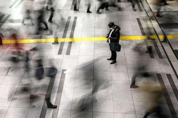 PHOTO: A man wearing a protective face mask, following an outbreak of the novel coronavirus, stands at the Shinagawa station in Tokyo, Japan, Feb. 28, 2020. (Athit Perawongmetha/Reuters)