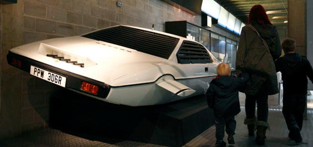 "A family walk past the Lotus Esprit underwater car from the James Bond film ""The Spy Who Loved Me"" at the press preview of the Bond in Motion exhibition at the Beaulieu National Motor Museum at Brockenhurst in the southern English county of Hampshire on January 15, 2012. The Bond in Motion exhbition features fifty original iconic vehicles used in the James Bond films to celebrate fifty years of 007 and will open to the public from January 17. AFP PHOTO / JUSTIN TALLIS"