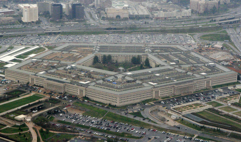 FILE - This March 27, 2008, file photo, shows the Pentagon in Washington. The Pentagon says the U.S. will send several dozen fighter jets along with other aircraft and additional air defenses to Saudi Arabia to help protect the kingdom from Iranian attacks. (AP Photo/Charles Dharapak, File)