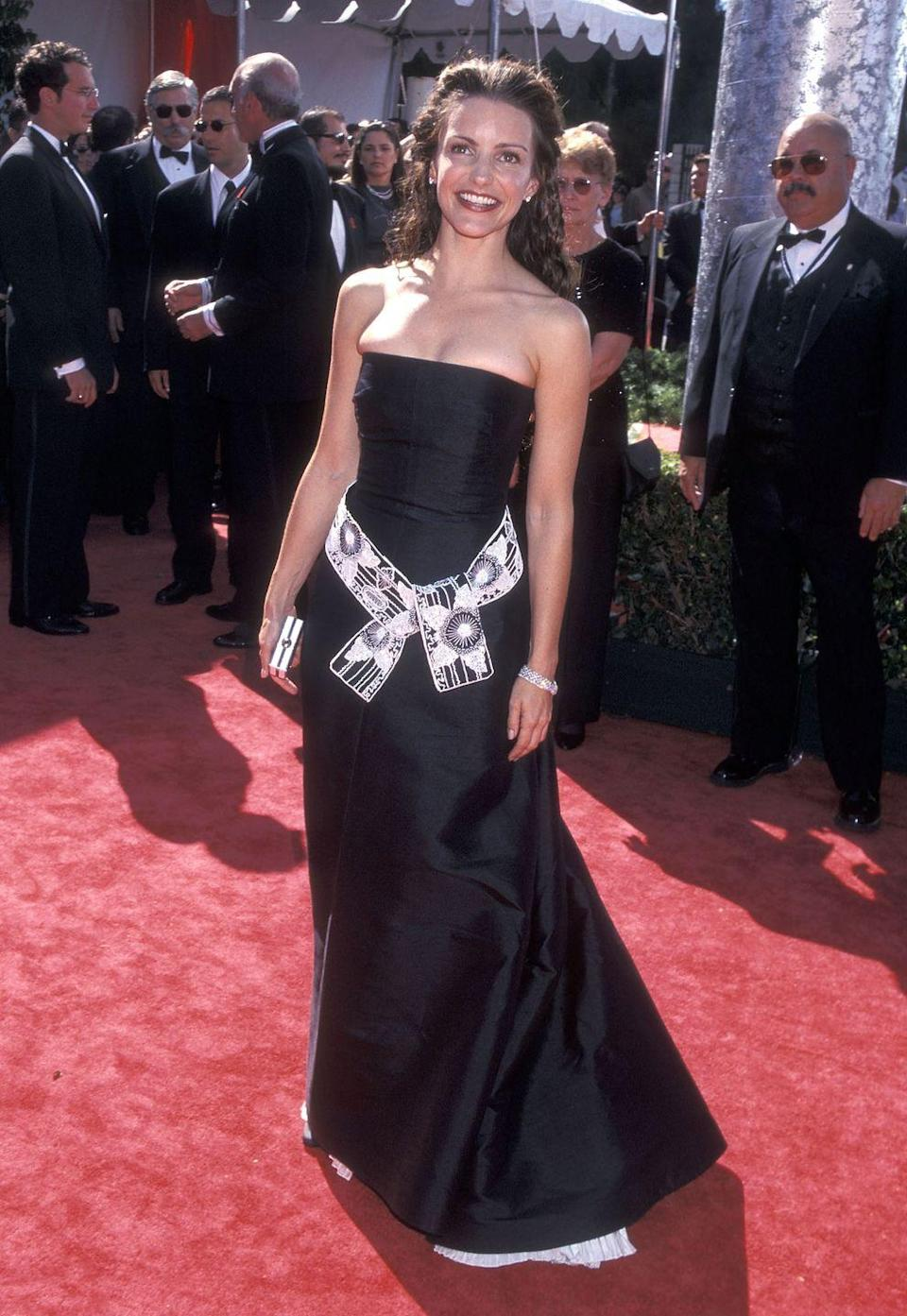 <p>Davis accented her black dress with a printed belt sash at the 1999 Emmy Awards. </p>