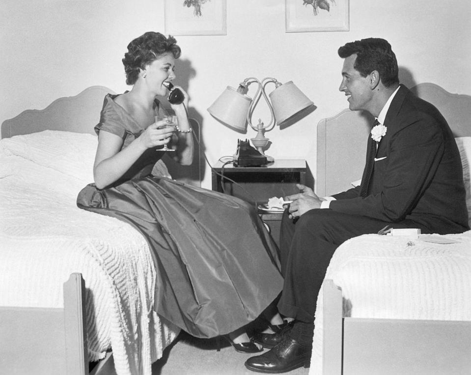 """<p>The actor's only marriage was to Phyllis Gates, an aspiring actress and interior designer, in 1955. As revealed in <em>Biography</em>, <a href=""""https://www.biography.com/actor/rock-hudson"""" rel=""""nofollow noopener"""" target=""""_blank"""" data-ylk=""""slk:the marriage was set up"""" class=""""link rapid-noclick-resp"""">the marriage was set up</a> by Hudson's agent to """"keep up appearances."""" Naturally, it didn't last long, and the pair divorced in 1957 while Hudson was in Italy filming <em>A Farewell to Arms</em>.</p>"""