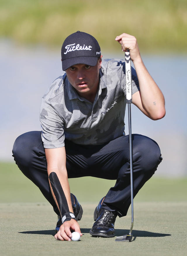 """FILE - In this March 2, 2019, file photo, Justin Thomas lines up a putt on the eighth hole during the third round of the Honda Classic golf tournament, in Palm Beach Gardens, Fla. Major champion. FedEx Cup champion. And now Justin Thomas has another title. Matchmaker for Michelle Wie and Jonnie West. Wie, the golf prodigy from Hawaii and former U.S. Women's Open champion, revealed on Instagram earlier this week that she was engaged to West, the Golden State Warriors' director of basketball operations and the son of NBA great Jerry West. And it all started with an exchange of text messages. """"They both asked me about each other,"""" Thomas said. (AP Photo/Wilfredo Lee, File)"""