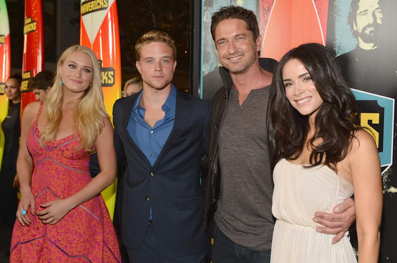 """LOS ANGELES, CA - OCTOBER 18:  Actors Leven Rambin, Jonny Weston, Gerard Butler and Abigail Spencer arrive to the premiere of 20th Century Fox's """"Chasing Mavericks"""" on October 18, 2012 in Los Angeles, California.  (Photo by Alberto E. Rodriguez/Getty Images)"""