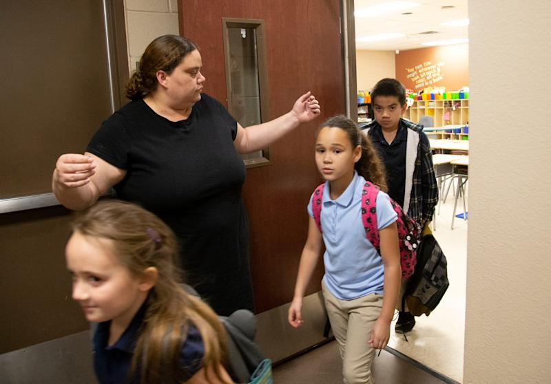 Third grade student teacher Christena Tamayo says goodbye to her students at the end of the school day at Copper Trails School in Goodyear on March 6, 2019.