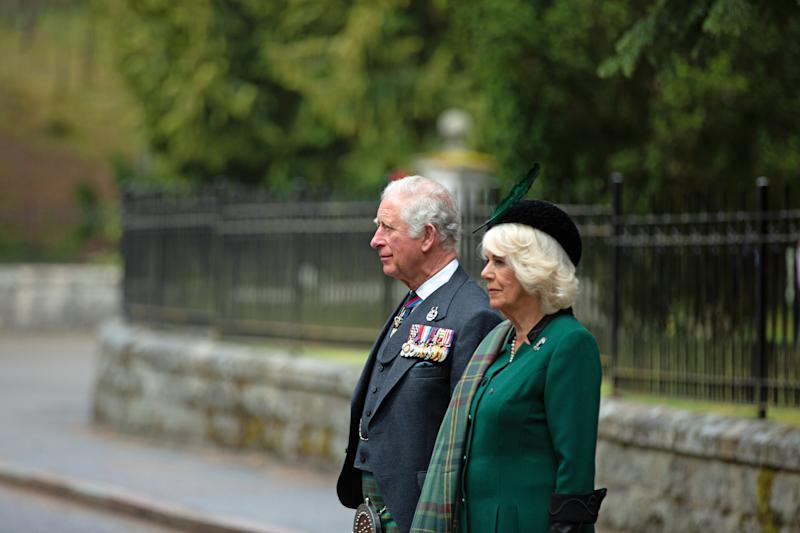 CRATHIE, SCOTLAND - MAY 8: In this picture released by Clarence House, Prince Charles, Prince of Wales and Camilla, Duchess of Cornwall (known as the Duke and Duchess of Rothesay when in Scotland) take part in a two minute silence to mark the 75th anniversary of VE Day at the Balmoral War Memorial on May 8, 2020 near Crathie, United Kingdom. During the event the Prince of Wales laid a wreath and the Duchess of Cornwall placed flowers at the memorial. The UK commemorates the 75th Anniversary of Victory in Europe Day (VE Day) with a pared-back rota of events due to the coronavirus lockdown. On May 8th, 1945 the Allied Forces of World War II celebrated the formal acceptance of surrender of Nazi Germany. (Photo by Amy Muir/WPA Pool/Getty Images)