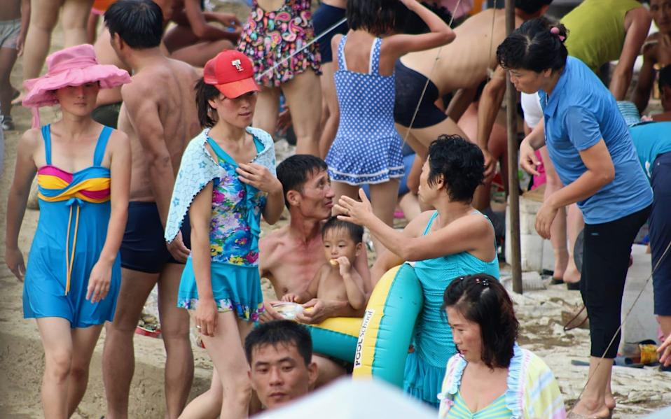North Koreans enjoy a moment of relaxation on a hot day - Lindsey Miller