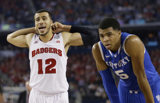 Wisconsin guard Traevon Jackson (12)and Kentucky guard Andrew Harrison (5) pause between plays during the second half of the NCAA Final Four tournament college basketball semifinal game Saturday, April 5, 2014, in Arlington, Texas. (AP Photo/David J. Phillip)