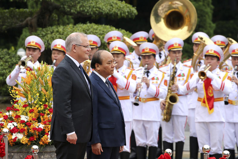 Australian Prime Minister Scott Morrison, left, with his Vietnamese counterpart Nguyen Xuan Phuc reviews an honor guard during a welcome ceremony at the Presidential Palace in Hanoi, Vietnam, Friday, Aug. 23, 2019. Morrison is on a three-day official visit to Vietnam. (AP Photo/Duc Thanh)