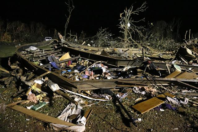 The frame of a mobile home is pictured with debris after a tornado hit a mobile home park near Dale, Okla., Sunday, May 19, 2013. (AP Photo Sue Ogrocki)