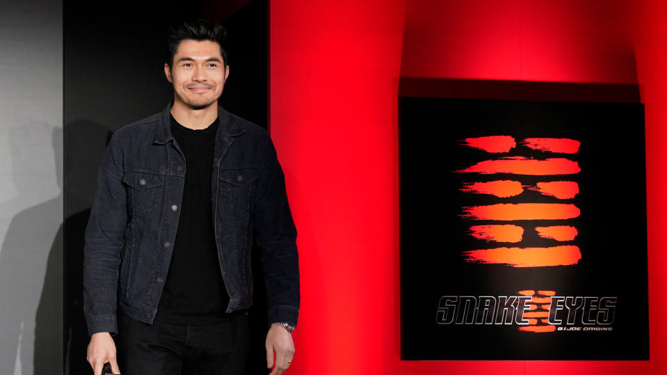 """Henry Golding attends the """"Snake Eyes"""" event at the Hie-Jinja Shrine on January 10, 2020. (Photo by Christopher Jue/Getty Images for Paramount Pictures)"""