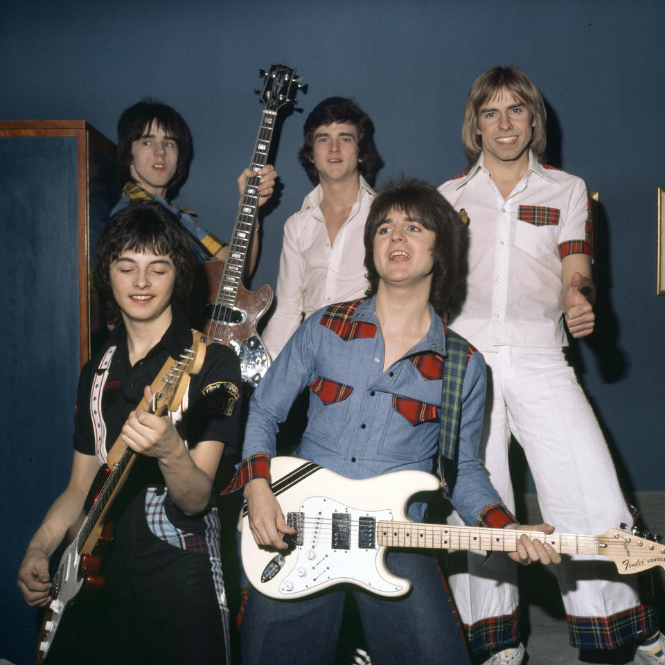 Pop group the Bay City Rollers, (back) Stuart Wood (Woody), Les McKeown,  Derek Longmuir (front) Ian Mitchell, Eric Faulkner , pose for a group shot in May 1976 in Copenhagen, Denmark. (Photo by Jorgen Angel/Redferns)