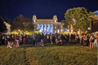 Students gathering on the Syracuse University campus on Wednesday Aug. 19, 2020, in Syracuse, NY. Syracuse University has issued suspensions to 23 students in the wake of the large on-campus gathering that administrators say could force them to shut down campus. College officials announced the disciplinary action late Thursday, Aug. 21, 2020. (Walter Freeman via AP)