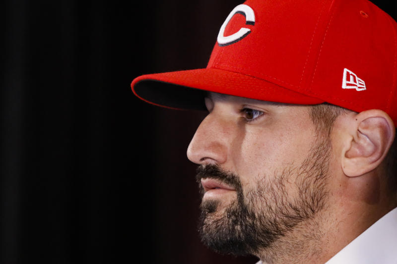 Cincinnati Reds' Nick Castellanos takes questions from reporters during a news conference, Tuesday, Jan. 28, 2020, in Cincinnati. Castellanos signed a $64 million, four-year deal with the baseball club. (AP Photo/John Minchillo)