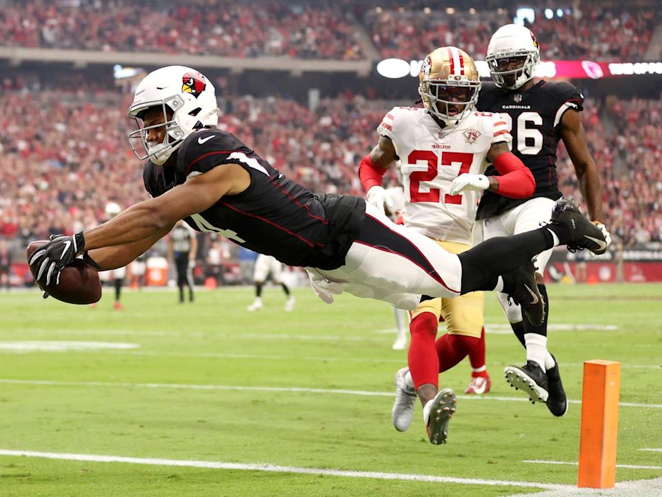 Rondale Moore dives for the end zone against the San Francisco 49ers.