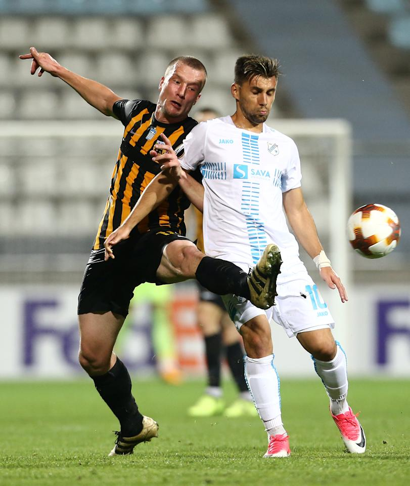 Soccer Football - Europa League - HNK Rijeka vs AEK Athens - Kantrida Stadium, Rijeka, Croatia - September 14, 2017   AEK's Jakob Johansson in action with Rijeka's Florentin Matei    REUTERS/Antonio Bronic