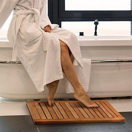 """Switch up your typical fuzzy bath mat look with this waterproof bamboo mat for only <a href=""""https://www.amazon.com/dp/B01DTEXFH8"""" target=""""_blank"""">$40</a>."""