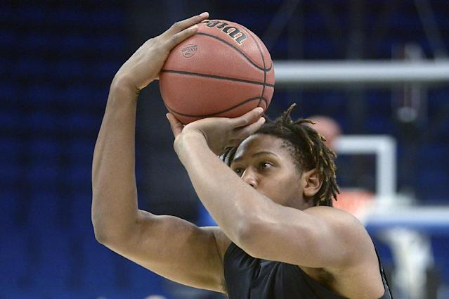 Colorado forward Xavier Johnson attempts a shot during a practice for an NCAA college basketball tournament game in Orlando, Fla., Wednesday, March 19, 2014. Colorado will face Pittsburgh in a second round game on Thursday. (AP Photo/Phelan M. Ebenhack)