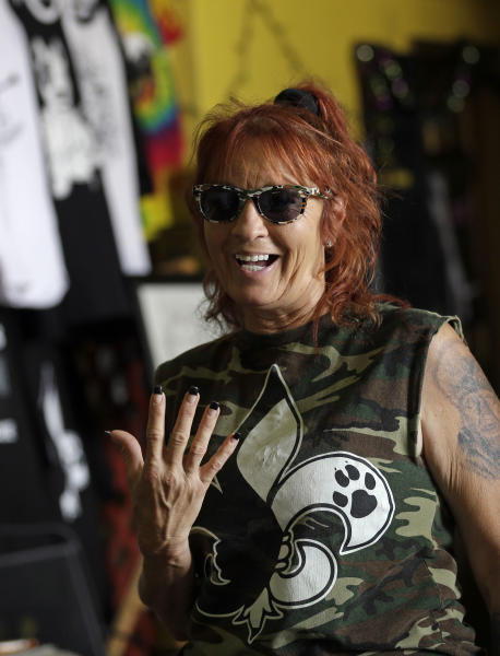 """In this Oct. 10, 2013, photo, Tia Maria Torres, star of Animal Planet's """"Pit Bulls and Parolees,""""speaks during a break while filming of an episode of the show's fifth season in New Orleans, Thursday, Oct. 10, 2013. Torres, who runs the nation's largest pit bull rescue center and has long paired abused and abandoned dogs with the parolees who care for them, has moved her long-running reality TV series from southern California to New Orleans, where hurricanes and overbreeding have left many pit bulls abandoned or abused. (AP Photo/Gerald Herbert)"""