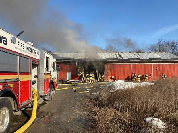 Firefighters and police discovered a 'clandestine' drug lab and grow-op after a fire Tuesdayat an agricultural building on Renaud Road. (Ottawa Fire Services - image credit)