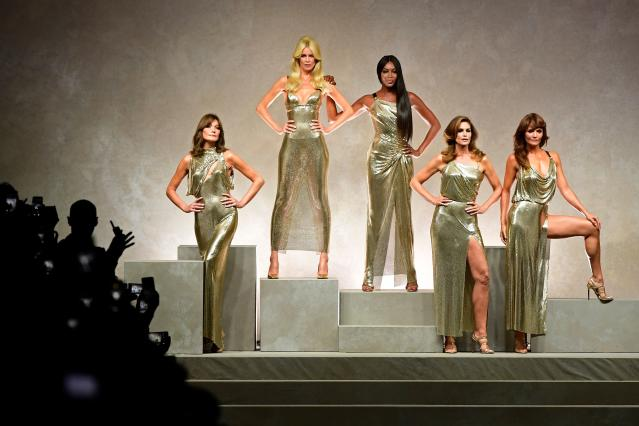 Top models, from left, Carla Bruni, Claudia Schiffer, Naomi Campbell, Cindy Crawford, and Helena Christensen for fashion house Versace in Milan, on Sept. 22. (Photo: Miguel Medina/AFP/Getty Images)