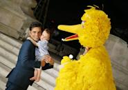 <p>John Stamos introduces his son Billy Stamos to <em>Sesame Street</em>'s Big Bird during an event in Washington D.C. in 2019. </p>