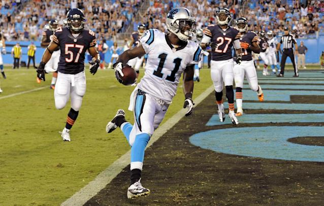 Carolina Panthers wide receiver Brandon LaFell (11) runs into the end zone for a touchdown past Chicago Bears linebacker Jon Bostic (57) during the first half of a preseason NFL football game in Charlotte, N.C., Friday, Aug. 9, 2013. (AP Photo/Mike McCarn)
