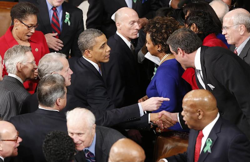 President Barack Obama is greeted after giving his State of the Union address during a joint session of Congress on Capitol Hill in Washington, Tuesday Feb. 12, 2013. (AP Photo/J. Scott Applewhite)