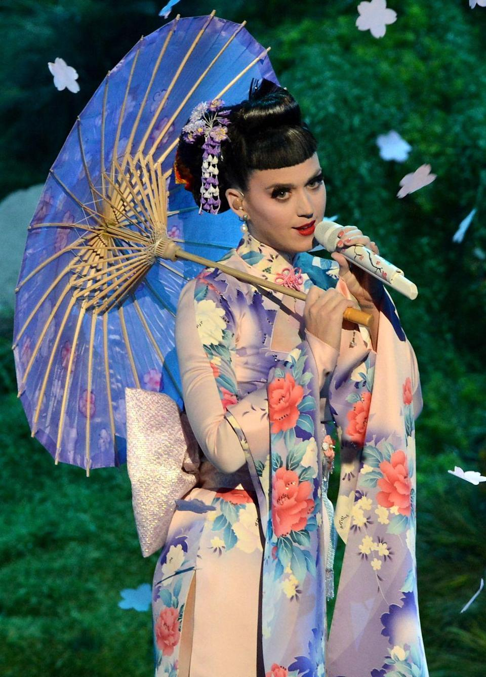 """<p>Katy Perry brought a """"geisha-inspired"""" look to her performance of """"Unconditionally"""" at the 2013 American Music Awards. Nolan Feeney at <em>The Atlantic</em> criticized her performance, writing, """"It's these kind of stereotypical visuals that plays into white fetishization of Asian women — something Perry doesn't have to deal with when she takes off her costume."""" </p>"""