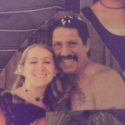 BuzzFeed user posing with Danny Trejo at his house in what looks like the 2000s