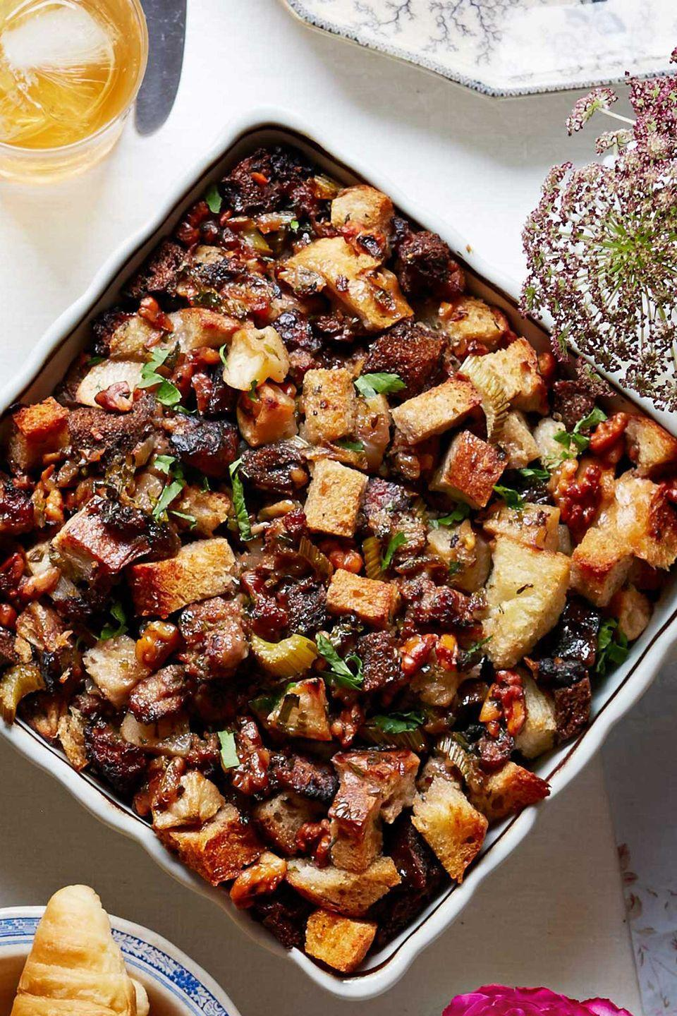 "<p>Stuffing isn't just for November—and this casserole style version is simply too good to pass up. Assemble this casserole up to a day ahead, and simply cover and chill.</p><p><strong><a href=""https://www.countryliving.com/food-drinks/recipes/a5271/apple-walnut-stuffing-recipe-clx1114/"" rel=""nofollow noopener"" target=""_blank"" data-ylk=""slk:Get the recipe"" class=""link rapid-noclick-resp"">Get the recipe</a>.</strong></p><p><strong><a class=""link rapid-noclick-resp"" href=""https://www.amazon.com/Wilton-Recipe-Non-Stick-9-Inch-Covered/dp/B07D9Z7PDC/?tag=syn-yahoo-20&ascsubtag=%5Bartid%7C10050.g.34554232%5Bsrc%7Cyahoo-us"" rel=""nofollow noopener"" target=""_blank"" data-ylk=""slk:SHOP BAKING PANS"">SHOP BAKING PANS</a><br></strong></p>"