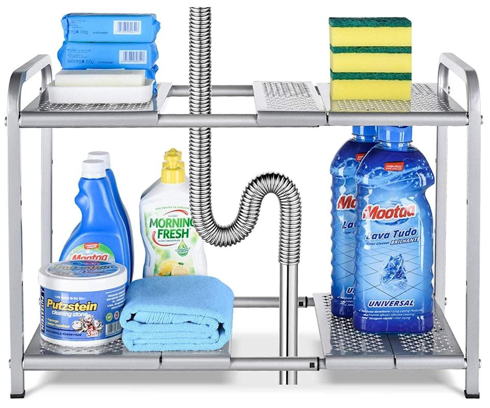 "<p>We love that this <a href=""https://www.popsugar.com/buy/Bextsware-Metal-Under-Sink-2-Tier-Expandable-Shelf-Organizer-548041?p_name=Bextsware%20Metal%20Under%20Sink%202-Tier%20Expandable%20Shelf%20Organizer&retailer=amazon.com&pid=548041&price=20&evar1=casa%3Aus&evar9=47203882&evar98=https%3A%2F%2Fwww.popsugar.com%2Fhome%2Fphoto-gallery%2F47203882%2Fimage%2F47204450%2FBextsware-Metal-Under-Sink-2-Tier-Expandable-Shelf-Organizer&list1=shopping%2Corganization%2Csmall%20space%20living%2Cbathrooms%2Chome%20organization%2Chome%20shopping&prop13=mobile&pdata=1"" class=""link rapid-noclick-resp"" rel=""nofollow noopener"" target=""_blank"" data-ylk=""slk:Bextsware Metal Under Sink 2-Tier Expandable Shelf Organizer"">Bextsware Metal Under Sink 2-Tier Expandable Shelf Organizer</a> ($20) is adjustable, so it will perfectly fit in your space.</p>"