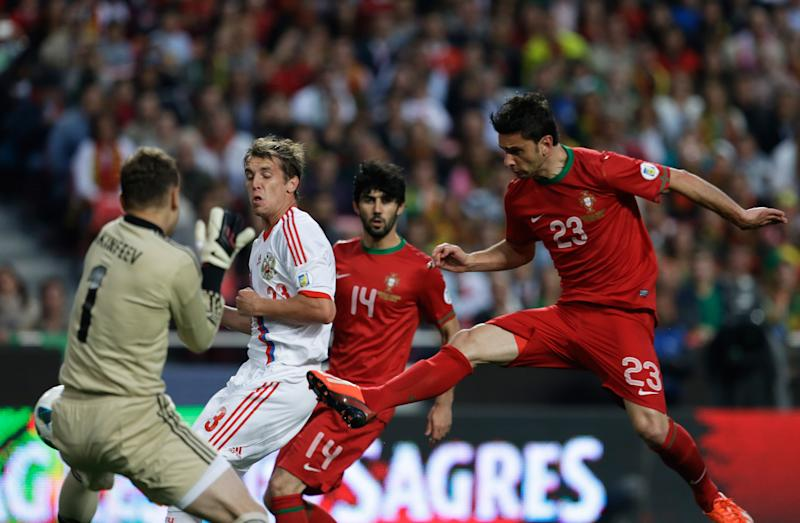 Portugal's Helder Postiga, right, scores the opening goal against Russia during their 2014 World Cup qualifying group F soccer match Friday, June 7 2013, at the Luz stadium in Lisbon. (AP Photo/Armando Franca)
